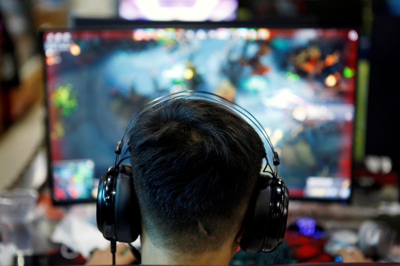 FILE PHOTO: Man plays online game on a computer at an internet cafe in Beijing