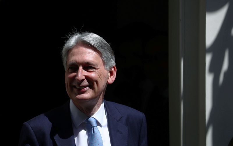 Chancellor of the Exchequer Philip Hammond leaves Downing Street in London