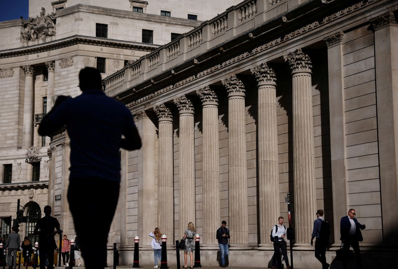 FILE PHOTO: People walk past the Bank of England during morning rush hour, amid the coronavirus disease