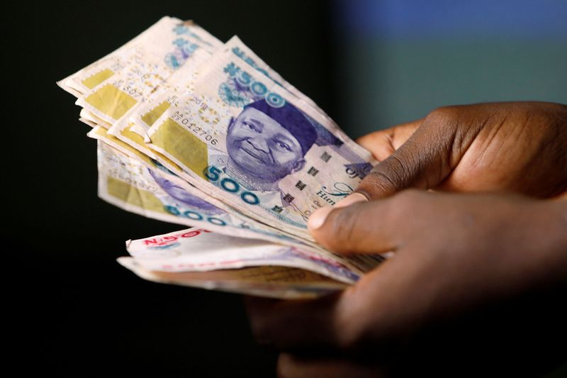 FILE PHOTO: Nigerian naira banknotes are seen in this picture illustration