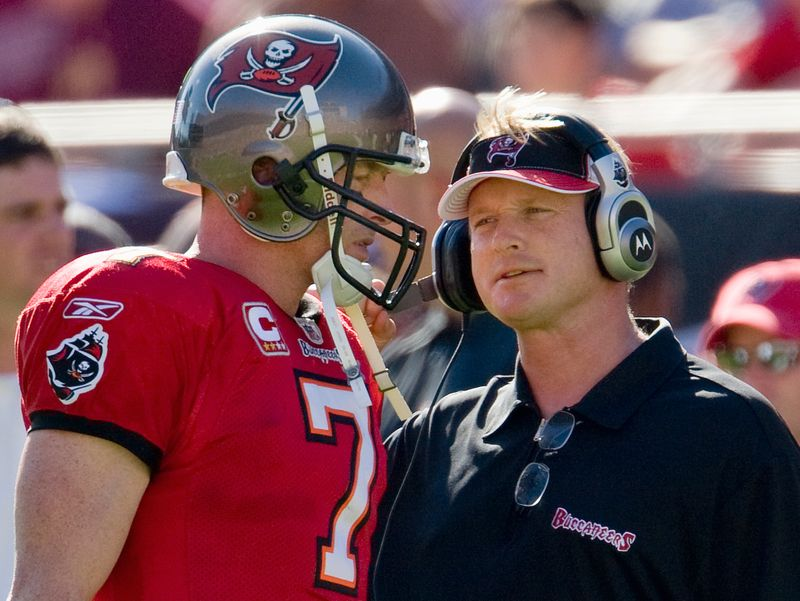 Tampa Bay Buccaneers quarterback Garcia gets instructions from head coach Gruden during NFL football game in Tampa