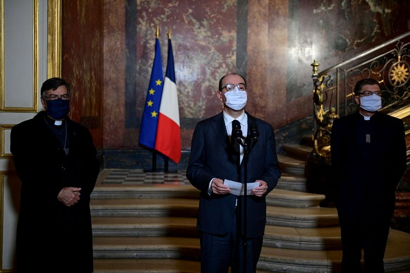 FILE PHOTO: Archbishop of Paris Michel Aupetit, French Prime Minister Jean Castex and President of Bishops' Conference of France Eric de Moulins-Beaufort talk to the press after their meeting at the Matignon Hotel in Paris