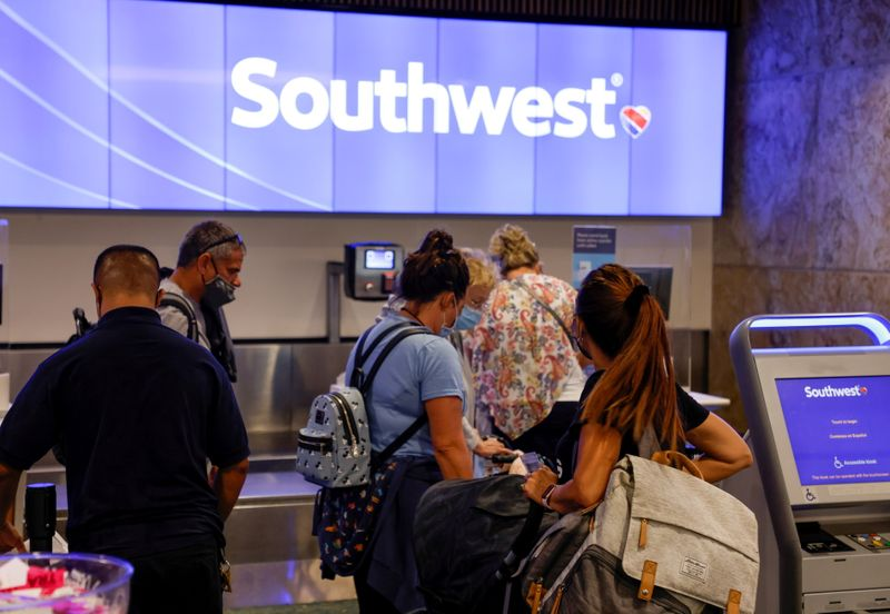 Passengers check in for a Southwest Airlines flight at Orlando International Airport in Orlando