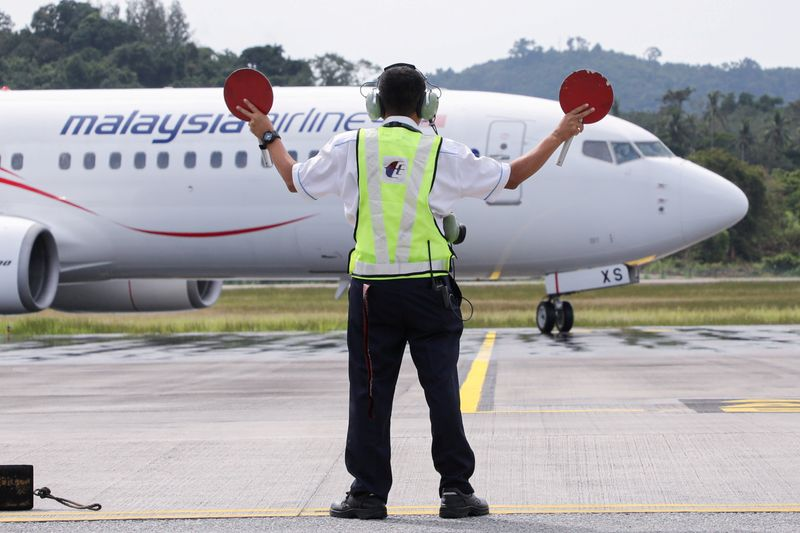 FILE PHOTO: A Malaysia Airlines plane carrying the first batch of tourists arrives as Langkawi reopens to domestic tourists, amid the coronavirus disease (COVID-19) pandemic, in Malaysia