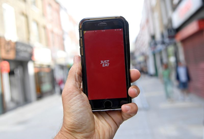 FILE PHOTO: The app for Just Eat is displayed on a smartphone in London