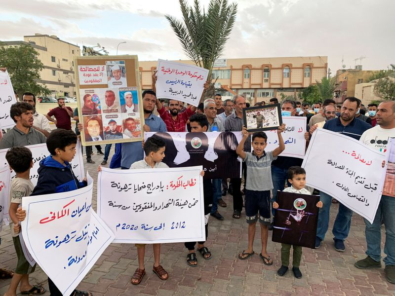 Families of the victims gather during a protest demanding justice for the missing people and mass graves, in Tarhouna