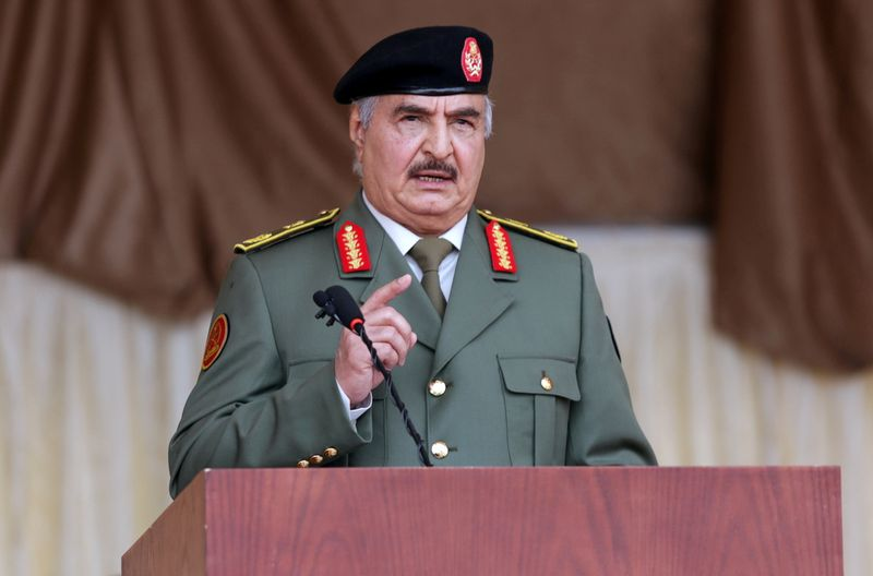 FILE PHOTO: Libyan military commander Khalifa Haftar gestures as he speaks during Independence Day celebrations in Benghazi
