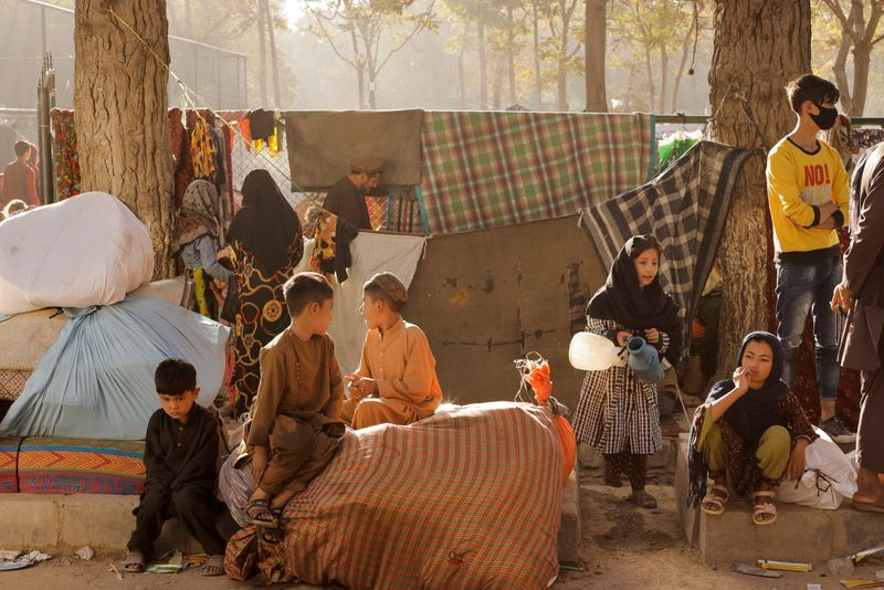 Displaced Afghan families, who flee the violence in their provinces, stay in a makeshift shelter, in Kabul