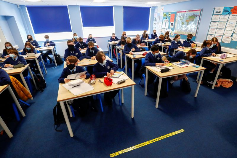FILE PHOTO: Students attend a lesson at Weaverham High School, as the coronavirus disease (COVID-19) lockdown begins to ease, in Cheshire, Britain, March 9, 2021