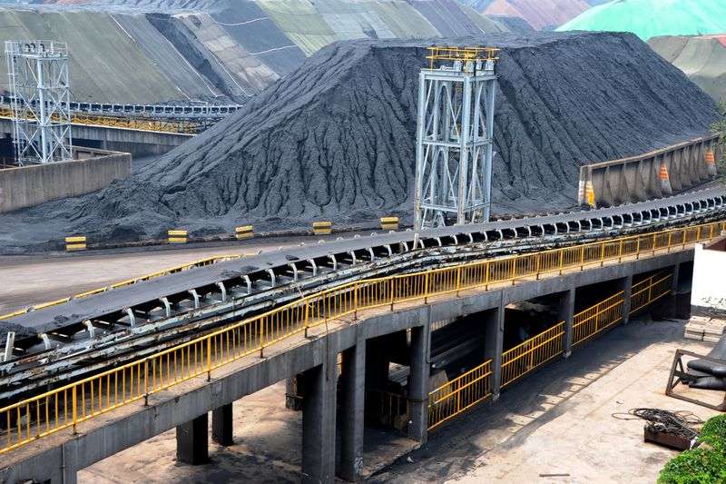 Piles of imported coal are seen at a coal terminal of a port in Lianyungang, Jiangsu