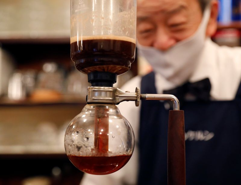 Shizuo Mori, the owner of Heckeln coffee shop brews coffee with a Syphon coffee maker at his shop in Tokyo