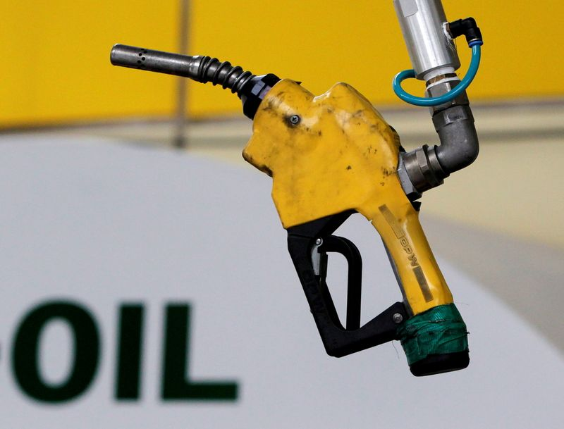 FILE PHOTO: FILE PHOTO: A gas pump is seen hanging from the ceiling at a petrol station in Seoul