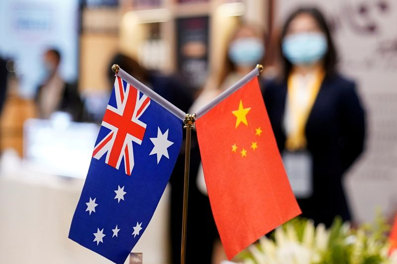FILE PHOTO: Australian and Chinese flags are seen at the third China International Import Expo (CIIE) in Shanghai