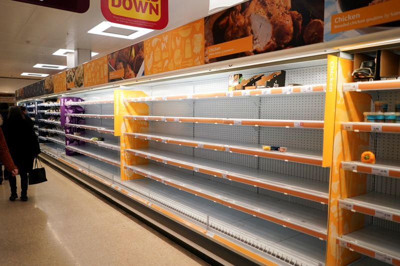 FILE PHOTO: Shelves empty of fresh chicken in a supermarket, as the number of worldwide coronavirus cases continues to grow,  in London