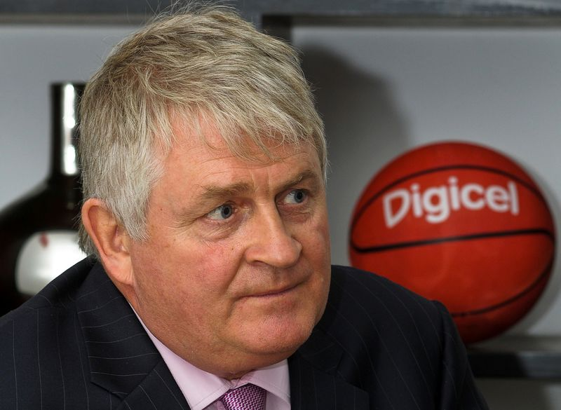 FILE PHOTO: Digicel Chairman Denis O'Brien attends an interview with Reuters at the company's headquarters in Port-au-Prince