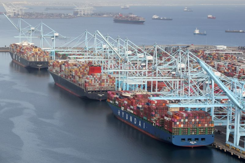 FILE PHOTO: FILE PHOTO: Shipping containers are unloaded from ships at a container terminal at the Port of Long Beach-Port of Los Angeles complex in Los Angeles