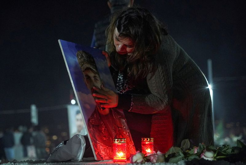 FILE PHOTO: Mourners commemorate Armenian service members killed in a conflict over the region of Nagorno-Karabakh in Yerevan