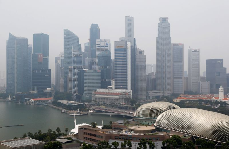 The financial district is seen shrouded by haze in Singapore