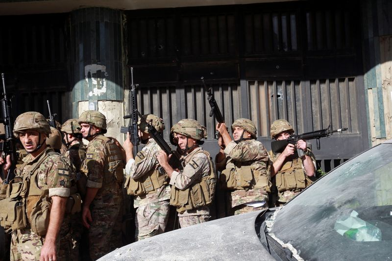 Army soldiers are deployed after gunfire erupted in Beirut