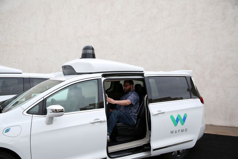FILE PHOTO: Early rider Alex Hoffman seen inside a Waymo self-driving vehicle, during a demonstration