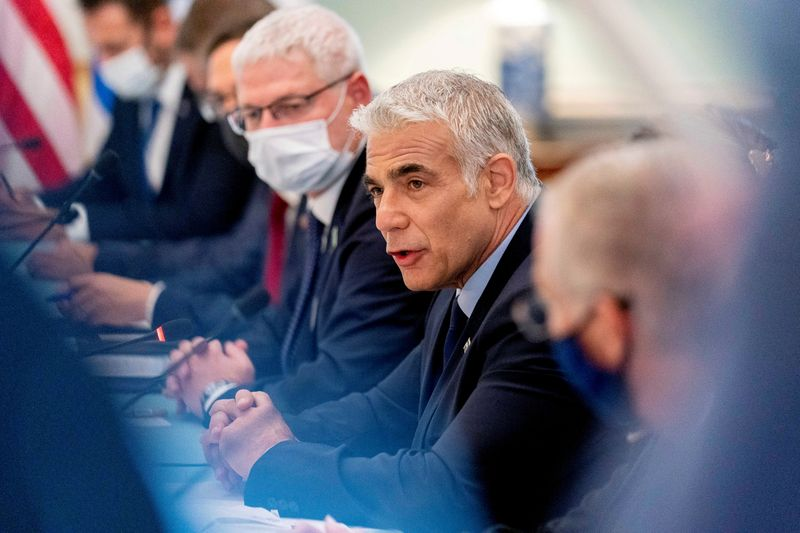 FILE PHOTO: Israeli Foreign Minister Yair Lapid speaks during a bilateral meeting with U.S. Secretary of State Antony Blinken at the State Department in Washington