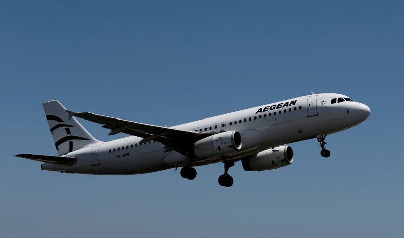 FILE PHOTO: An Aegean Airlines Airbus A320 aircraft takes off from the Eleftherios Venizelos International Airport in Athens