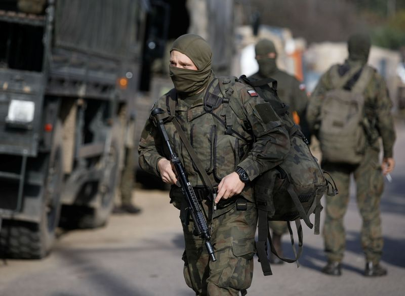 Polish Army soldiers are seen in front of the Border Guard headquarters in Michalowo