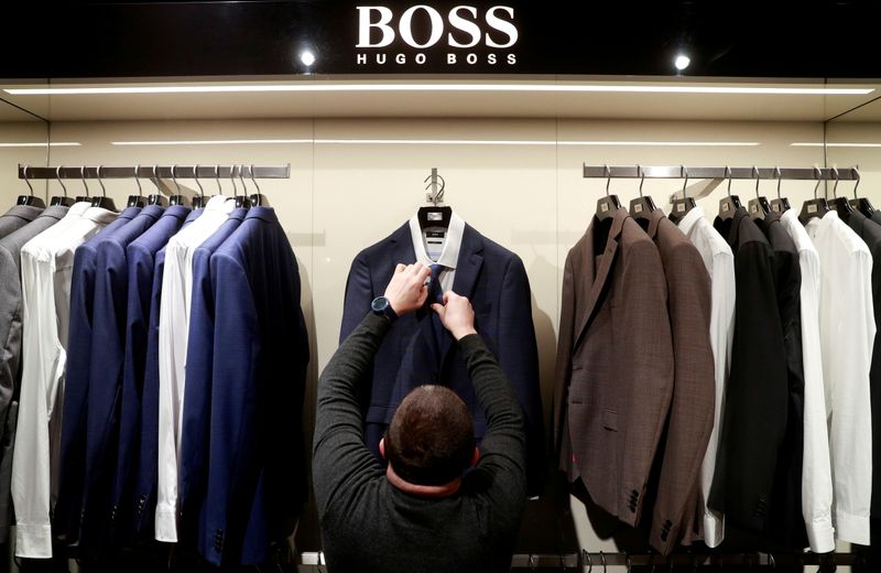 FILE PHOTO: FILE PHOTO: An employee at a Hugo Boss outlet in Kyiv, Ukraine