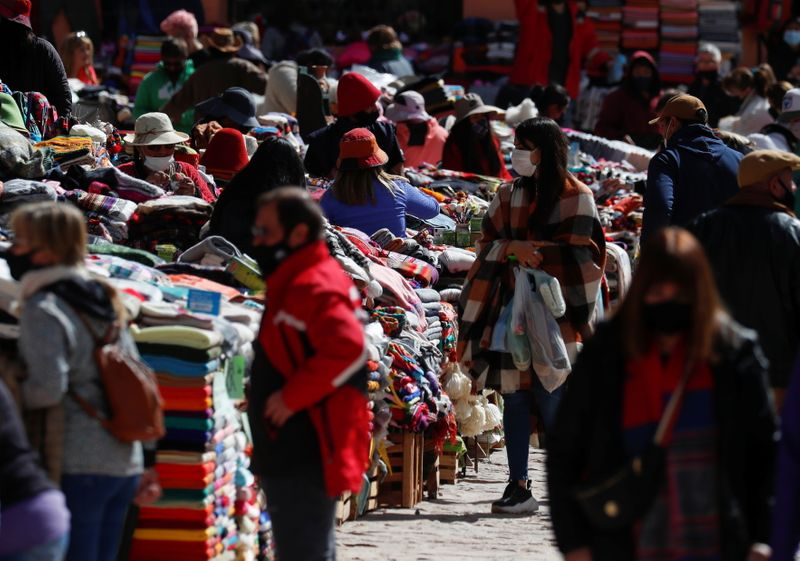 Costumers shop at a street market, in Purmamarca, Jujuy