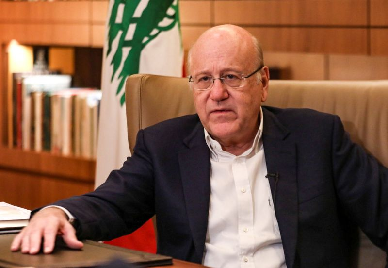 Lebanese Prime Minister Najib Mikati speaks during an interview with Reuters at the government palace in Beirut