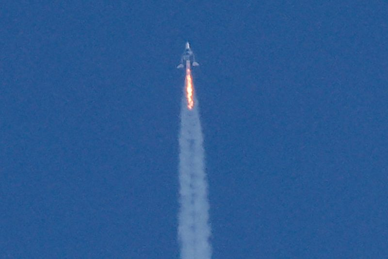FILE PHOTO: Virgin Galactic's passenger rocket plane VSS Unity begins ascent to the edge of space above Spaceport America