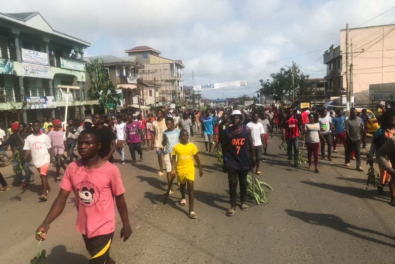 Residents protest through the streets after the killing of a a five-year-old girl by a military police officer in Buea, Cameroon