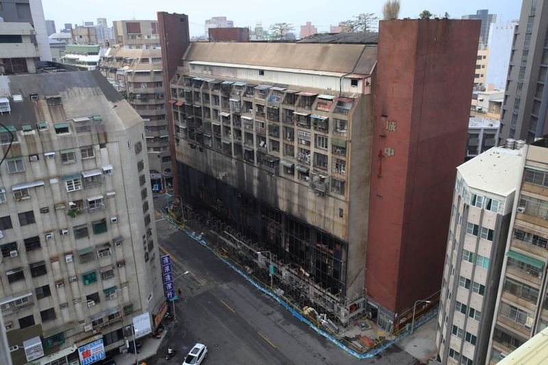 Damaged residential building following a fire is pictured in Kaohsiung