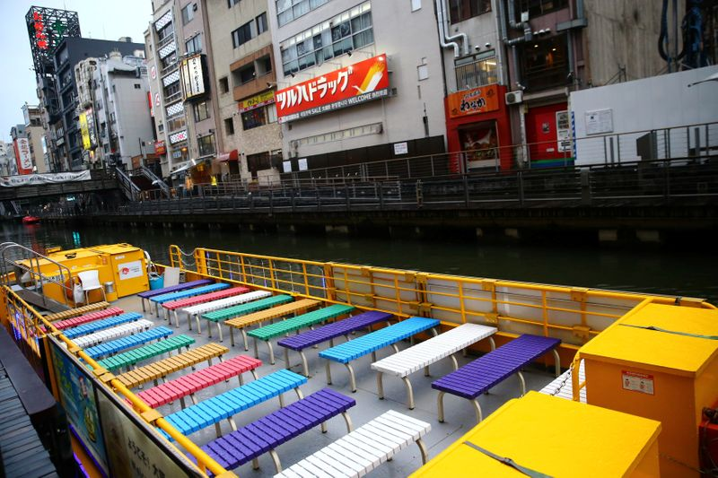 FILE PHOTO: A ship is pictured on an almost empty port in the Dotonbori amusement district of Osaka