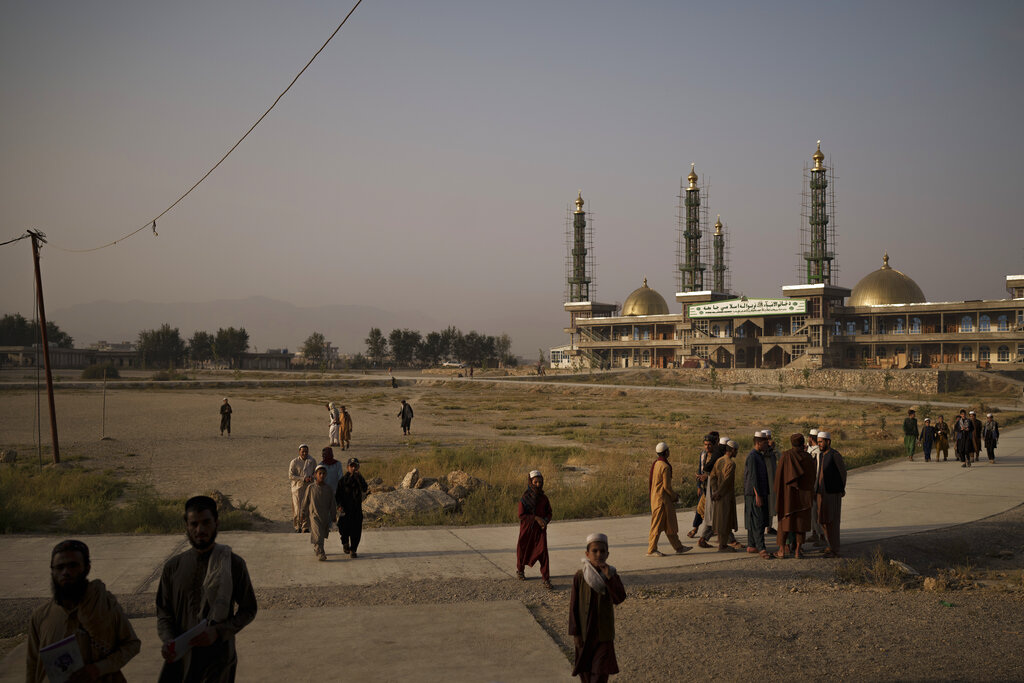 Afghan students walk out of the mosque at the Khatamul Anbiya madrasa after morning prayers in Kabul, Afghanistan, Wednesday, Sept. 29, 2021. (AP Photo/Felipe Dana)