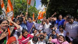 Activists of Congress party's youth wing protesting against Sunday's killing of four farmers in Uttar Pradesh state after being run over by a car owned by India's junior home minister shout slogans in New Delhi, India, Monday, Oct. 4, 2021. Indian authorities suspended internet services and barred political leaders from entering a northern town Monday to calm tensions after nine people were killed in a deadly escalation of a yearlong demonstration against contentious agriculture laws. (AP Photo/Manish Swarup)