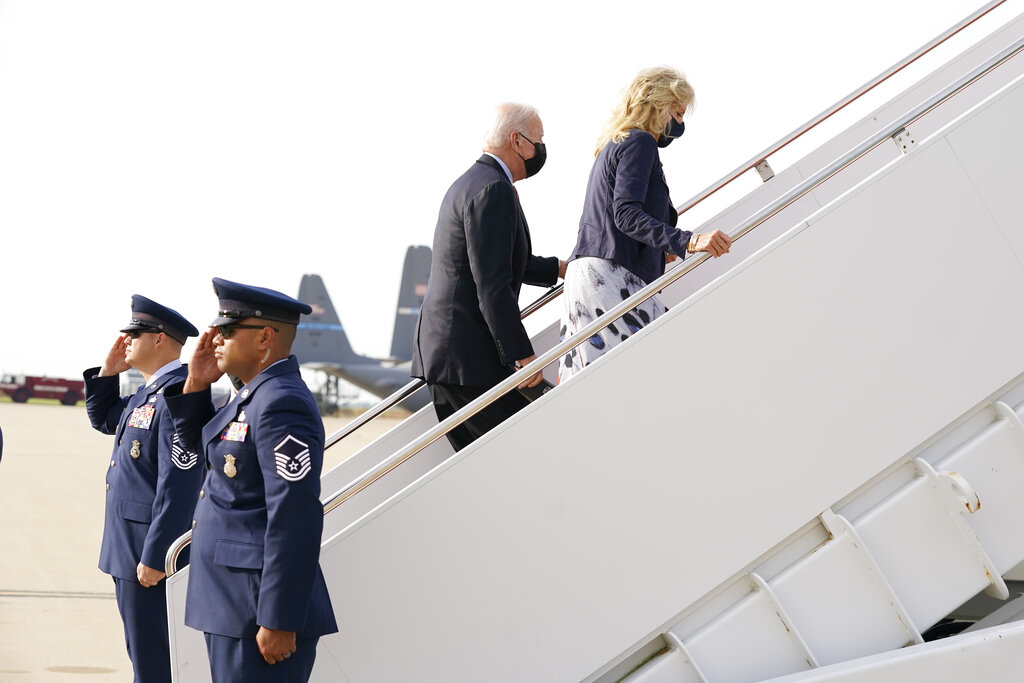 President Joe Biden and first lady Jill Biden board Air Force One, Monday, Oct. 4, 2021 at Delaware Air National Guard Base in New Castle, Del. Biden is returning to the White House after spending the weekend at their Delaware home. (AP Photo/Manuel Balce Ceneta)