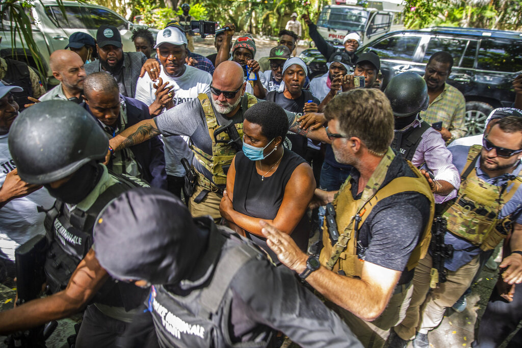 Martine Moise, the widow of slain President Jovenel Moise, center, arrives to the courthouse to give testimony in the ongoing investigation into the assassination of her husband in Port-au-Prince, Haiti, Wednesday, Oct. 6, 2021. (AP Photo/Joseph Odelyn)