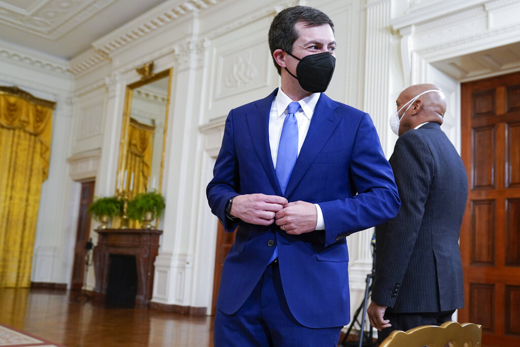 Transportation Secretary Pete Buttigieg arrives to attend an event on the global supply chain bottlenecks during in the East Room of the White House, Wednesday, Oct. 13, 2021, in Washington. (AP Photo/Evan Vucci)