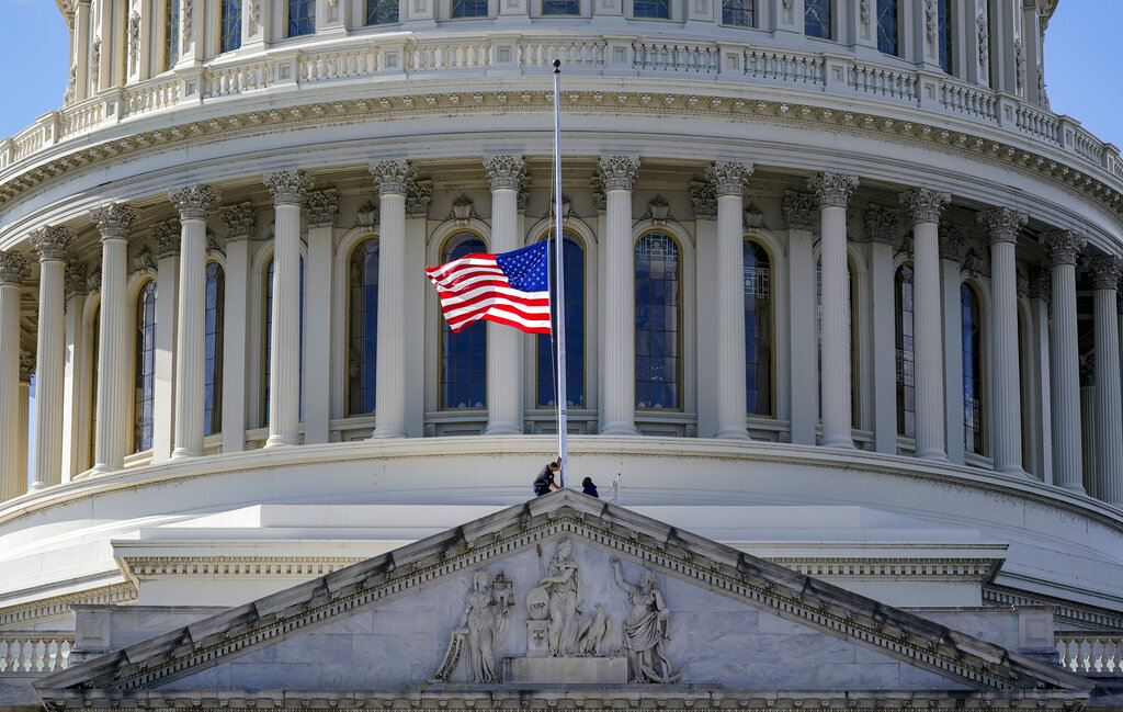 The American flag is set to half-staff at the Capitol in Washington, Monday, Oct. 18, 2021, in honor of Colin Powell, former Joint Chiefs chairman and secretary of state, who died from COVID-19 complications. (AP Photo/J. Scott Applewhite)