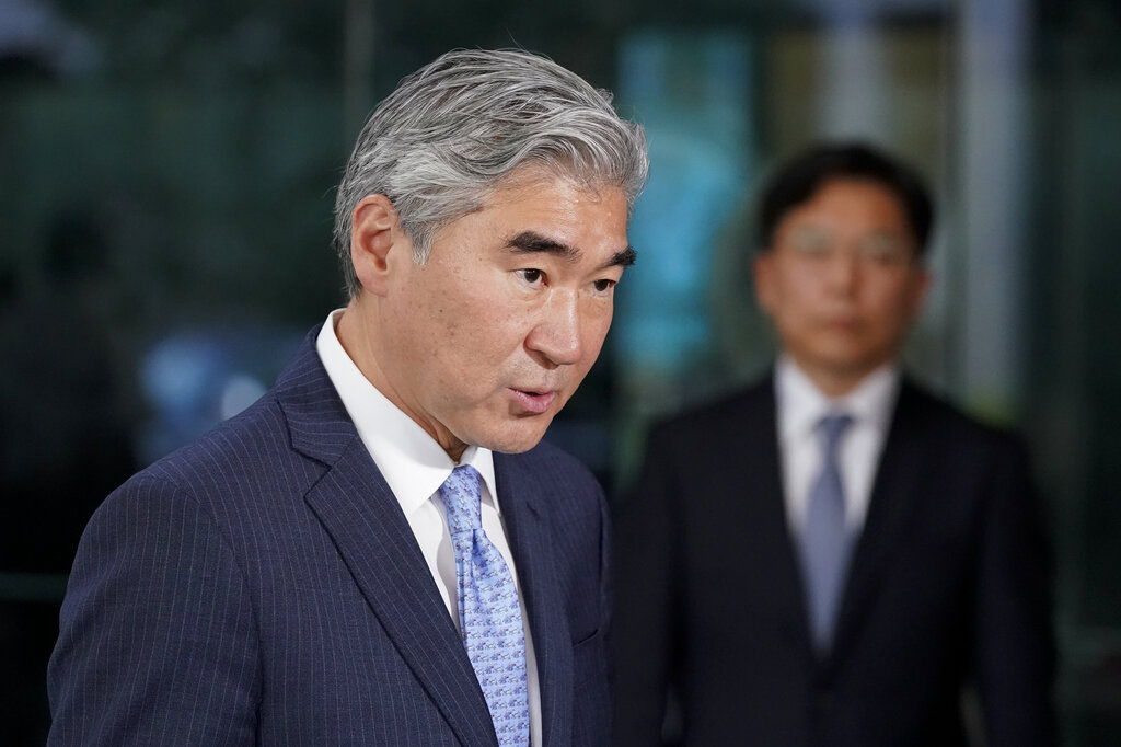 U.S. Special Representative for North Korea, Sung Kim, speaks after a meeting with South Korea's Special Representative for Korean Peninsula Peace and Security Affairs Noh Kyu-duk, back right, Monday, Oct. 18, 2021, at the U.S. State Department in Washington. (AP Photo/Patrick Semansky)