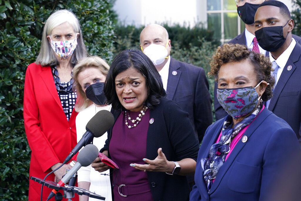 Rep. Pramila Jayapal, D-Wash., the chair of the Congressional Progressive Caucus, center, along with other lawmakers, talks with reporters outside the West Wing of the Washington, Tuesday, Oct. 19, 2021, following their meeting with President Joe Biden. Jayapal is joined by from left, Rep. Katherine Clark, D-Mass., Rep. Debbie Dingell, D-Mich., Rep. Mark Pocan, D-Wis., Rep. Barbara Lee, D-Calif., and Rep. Ritchie Torres, D-New York. (AP Photo/Susan Walsh)