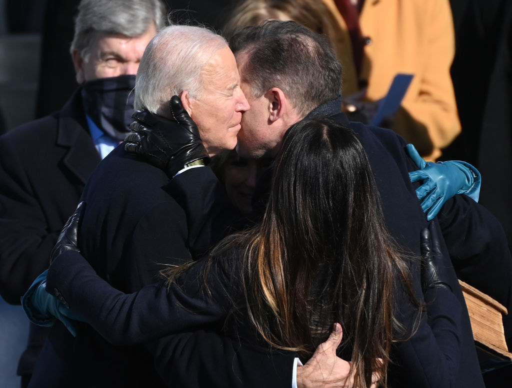 Joe Biden embraces son Hunter and family members after taking the oath of office during his swearing-in ceremony as the 46th US President on January 20, 2021, at the US Capitol in Washington, DC. (Photo by Brendan SMIALOWSKI / AFP) (Photo by BRENDAN SMIALOWSKI/AFP via Getty Images)