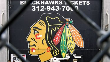 CHICAGO - FEBRUARY 16: Blackhawk?s ticket information and team logo are seen on the back of a truck through a fence outside of the United Center, the home of the Chicago Blackhawks, February 16, 2005 in Chicago, Illinois. The 2004-2005 National Hockey League season has been canceled due do to the owners and players failing to reach a labor agreement. (Photo by Tim Boyle/Getty Images)