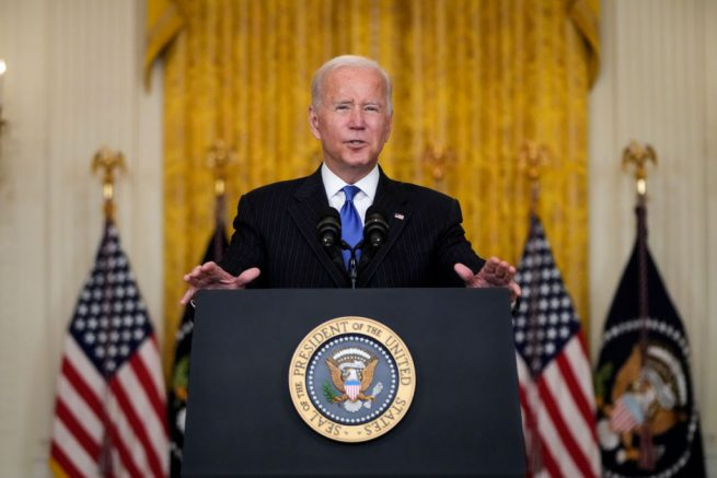 WASHINGTON, DC - OCTOBER 13: U.S. President Joe Biden speaks about supply chain bottlenecks in the East Room the White House October 13, 2021 in Washington, DC. With the holiday season approaching, President Biden announced that the Port of Los Angeles will begin to operate 24 hours a day in efforts to relieve the backlog in the supply chain that delivers goods to the United States. Americans have seen delays in a host of consumer goods, including electronics, cars, lumber, toys and more. (Photo by Drew Angerer/Getty Images)