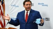 Florida Gov. Ron DeSantis speaks holding his facemask during a press conference to address the rise of coronavirus cases in the state, at Jackson Memorial Hospital in Miami, on July 13, 2020. - Virus epicenter Florida saw 12,624 new cases on July 12 -- the second highest daily count recorded by any state, after its own record of 15,300 new COVID-19 cases a day earlier. (Photo by CHANDAN KHANNA / AFP) (Photo by CHANDAN KHANNA/AFP via Getty Images)