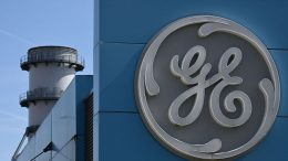 The logo of US giant General Electric is pictured on the Belfort plant, eastern France, on March 29, 2021. (Photo by SEBASTIEN BOZON / AFP) (Photo by SEBASTIEN BOZON/AFP via Getty Images)