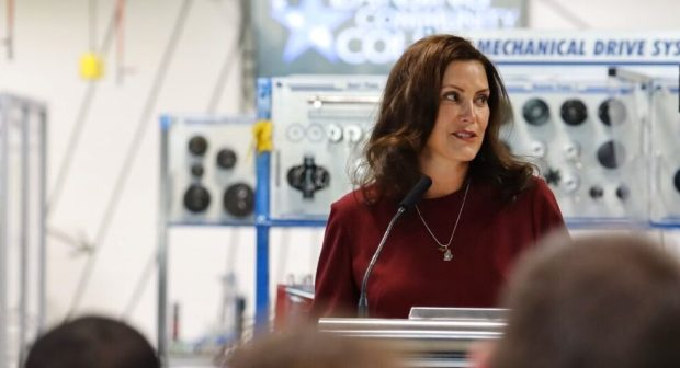 This photo provided by the Michigan Office of the Governor, shows Gov. Gretchen Whitmer as she addresses the state during a speech Sept. 29, 2021, in Delta Township, Mich, Gov. Whitmer spoke about signs budget legislation at a bill-signing event at Lansing Community College's robotics lab in Delta Township. The next state budget takes effect Friday, Oct. 1, 2021. (Michigan Office of the Governor via AP, File)