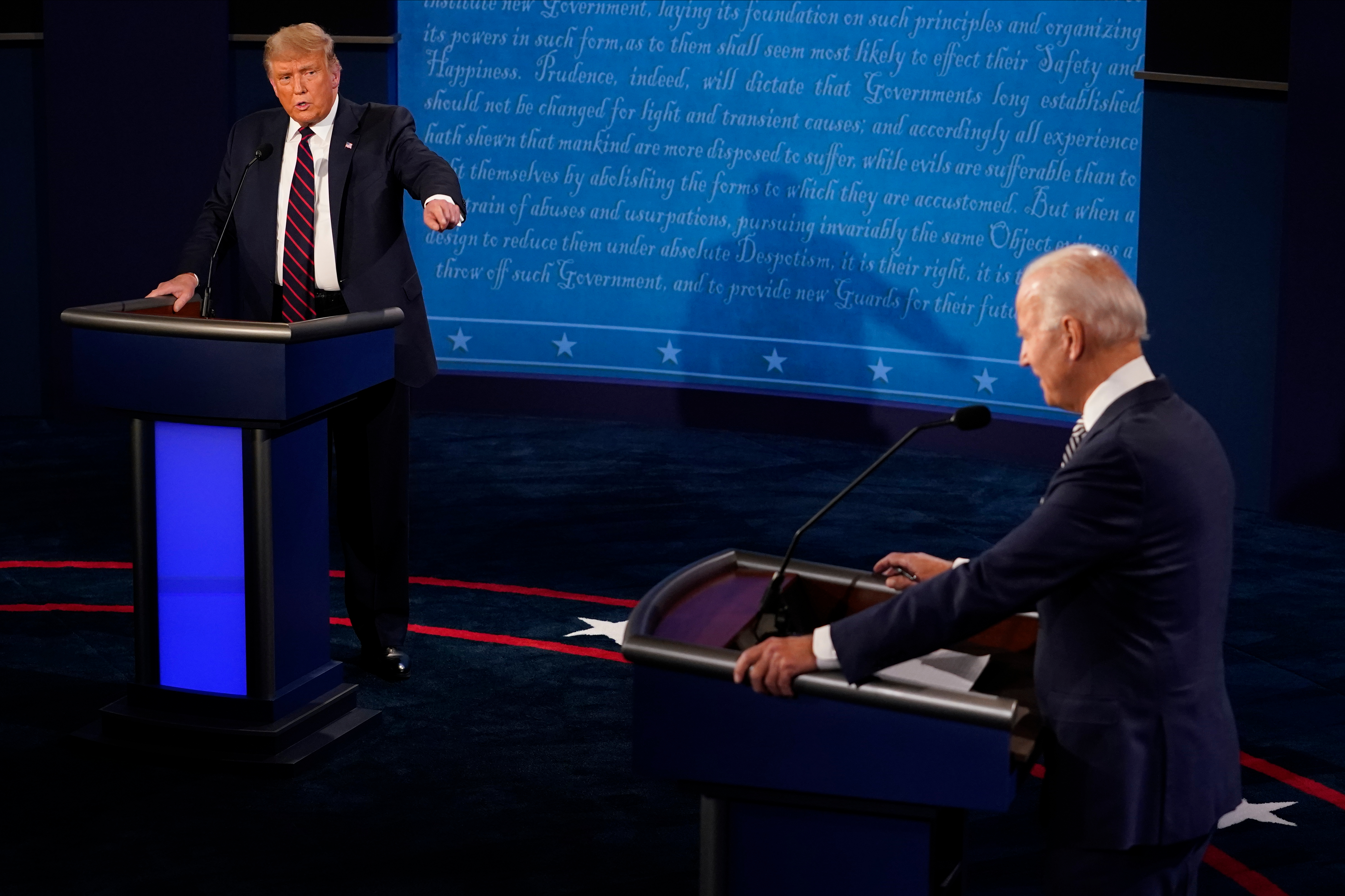 President Donald Trump and Joe Biden speak during the first presidential debate at the Health Education Campus of Case Western Reserve University on in Cleveland, Ohio. (Photo by Morry Gash-Pool/Getty Images)
