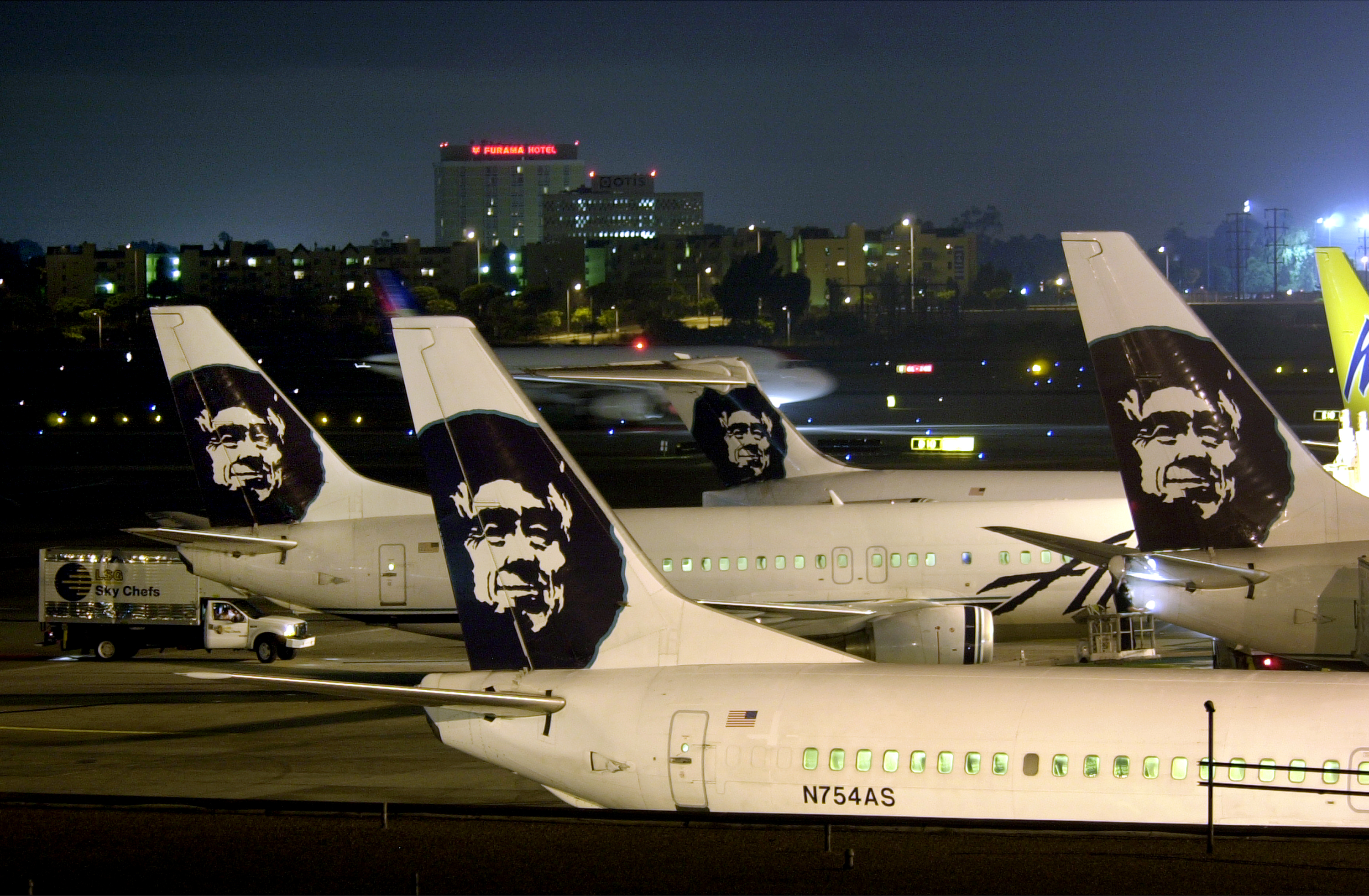 Alaska Airlines jets are parked at their terminal at Los Angeles International Airport. (Photo by David McNew/Getty Images)